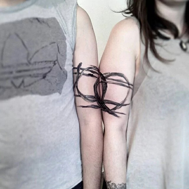 cool couple arm tattoo