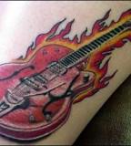 Anyone Love Their Guitar Tattoo Design