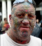 Bold Amazing Men Face Tattoo