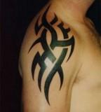 Cool Minimalistic Upper Arm Tribal Tattoo Idea For Guys