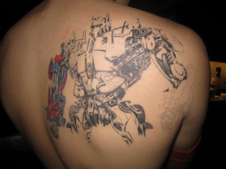 optimus prime tattoo design for your body art. Black Bedroom Furniture Sets. Home Design Ideas