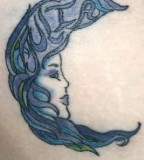 Women Face Crescent Moon Tattoo