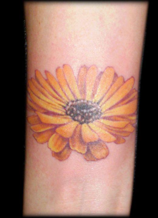 Daisy Tattoos On Foot: Lovely Feminine Orange Daisy Flower Tattoo Design