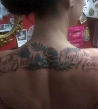 Danielle Colby Cushman Upper Back Tattoo