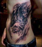 Dark Angel with Face and Wings Tattoo Designs
