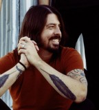Fantastic Dave Grohl Feather Tattoo with Red Shirt Combination