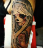 Dead Blonde Doll Tattoo Design on Upper Arm