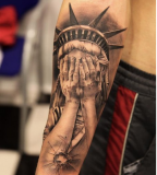 Statue Of Liberty Tattoo Design On Sleeve