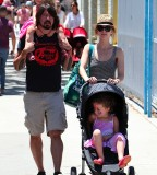 Dave Grohl's Feather Tattoo on His Forearm