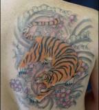 Cool Dragon Fighting Tiger Tattoo