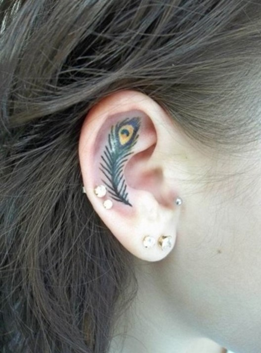ear feather tattoo