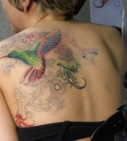 Beautiful Swirly Flowers and Hummingbird Back Tattoo Designs for Women