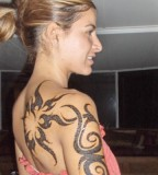 Feminine Tribal Swirls Half-Sleeve to Upper-back Tattoos Designs for Women