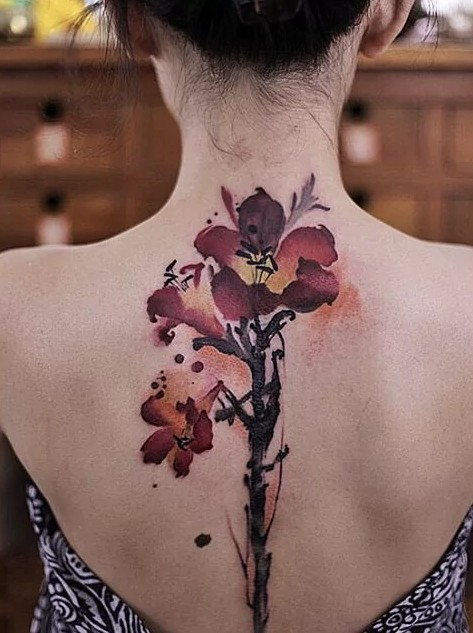 flower down spine tattoos for women
