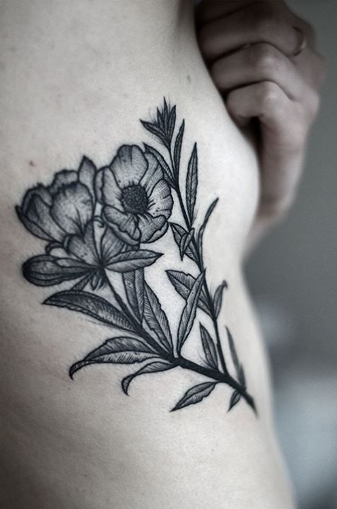 flower tattoo by Kamil Czapiga