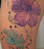 2 Flower Stars Butterflies Tattoo On Thigh