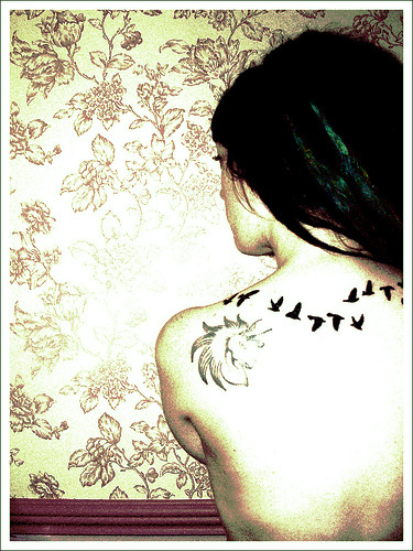 Amazing Imaginative Flying Bird Silhouette Tattoo