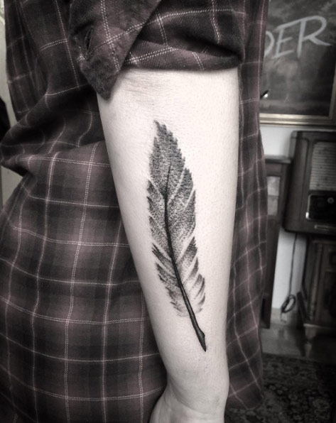 grey feather tattoo
