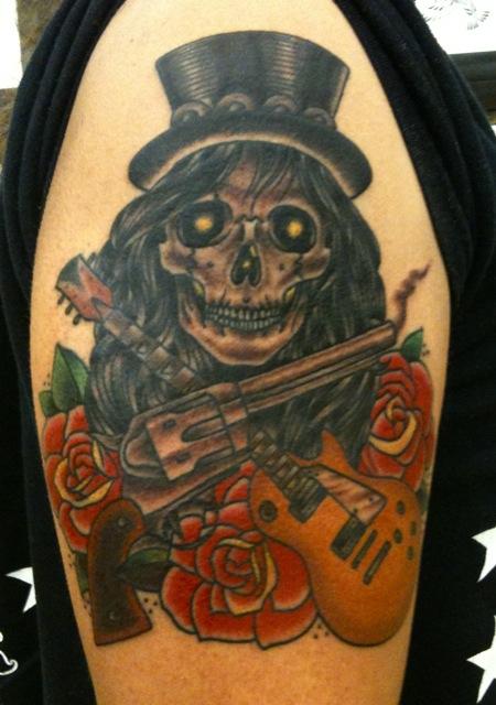 guns n roses tattoo design at upper arm. Black Bedroom Furniture Sets. Home Design Ideas