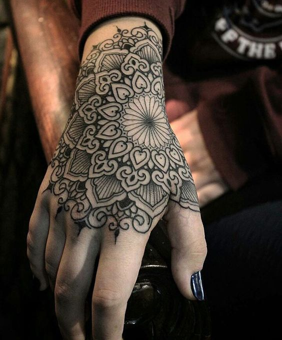 hand intricate mandala tattoo