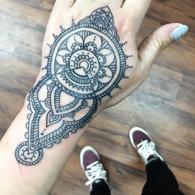 hand mandala tattoo