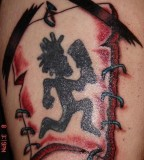 On Arm Hatchet Man Tattoo