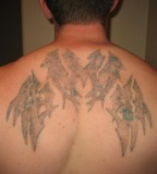 Healed White Ink Tattoo Design on Upper Back