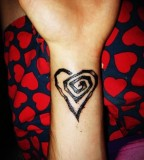 Circular Line Heart Design Tattoo On Wrist