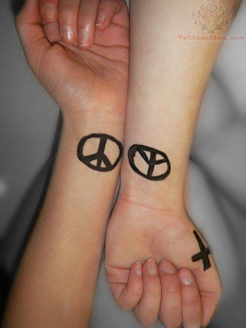 Peace Sign Symbol Tattoo Designs Peace Symbol Tattoos on Wrists