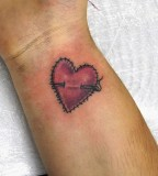 Stiched Heart Tattoo On Wrist