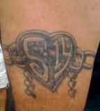Awesome Heartlocket Chain Tattoo Design Idea