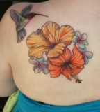 Beautiful Hibiscus Tattoos On Upper Back Picture