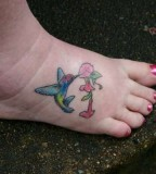 Tiny Hummingbird and Flower Tattoo On Foot
