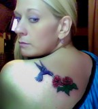 Green Hummingbird And Red Flower Tattoo On Left shoulder.