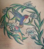 Cute Hummingbird Flower Tattoo Design