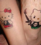 Amazing Hello Kitty Husband And Wife Tattoos