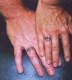 Pian Husband And Wife Matching Tattoos Photo