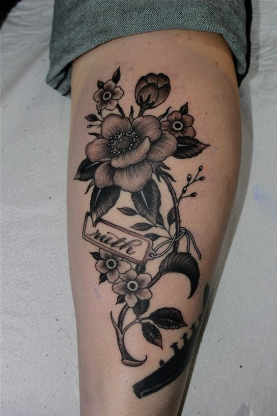 leg flower tattoo