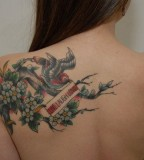 Live Laugh Love with a Bird on Branches Tattoo