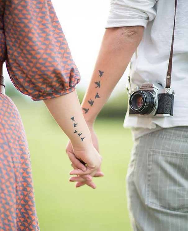 matching flying birds couples tattoos