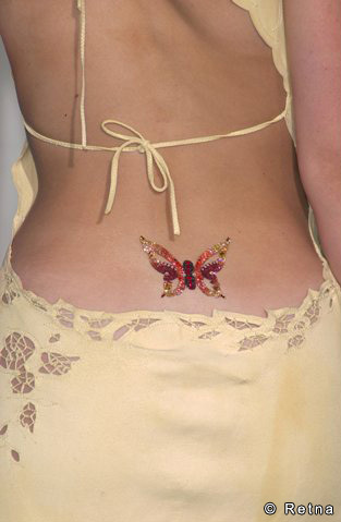 Small Glittery Monarch Butterfly Lower Back Tattoo For Girls