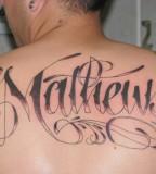 Tribal Name Tattoo For Man