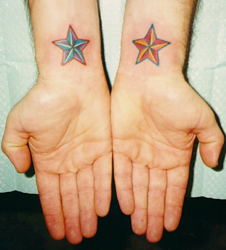 Red and blue stars tattoo on wrist for Blue star tattoo