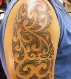 Kiss gene simons retro rock band face bicep 39 s tattoo for Painful pleasures tattoo