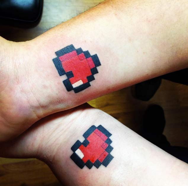 pixeled hearts couple tattoo