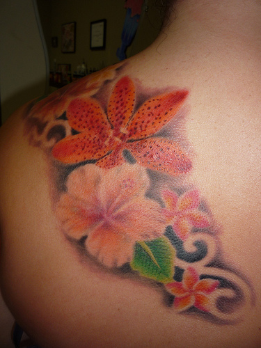 amazing plumeria tattoos design on shoulder. Black Bedroom Furniture Sets. Home Design Ideas
