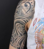 Great Tribal Quarter Sleeve Tattoo Design