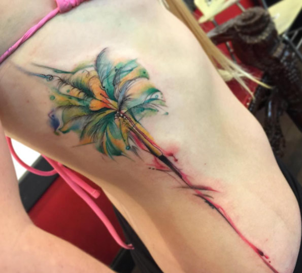 ribcage watercolor flower tattoo