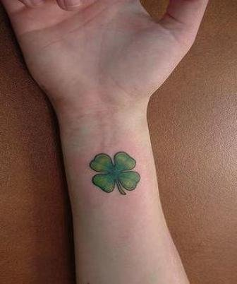 Shamrock tattoo pictures in the right arm tattoomagz for Clover tattoo meaning