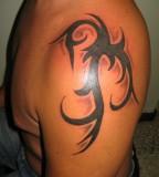 Cool Tribal Shoulder Tattoo For Men
